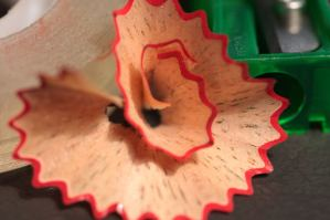 red colored pencil shaving, flower shaped